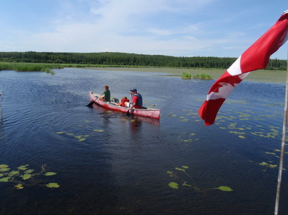kelly w boys and flag canoeing_resize